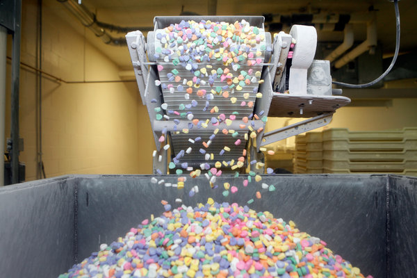 Sweethearts Conversation Hearts roll off the conveyor belt at the New England Confectionery Company in Revere, Mass. Credit Greg M. Cooper, via The New York Times