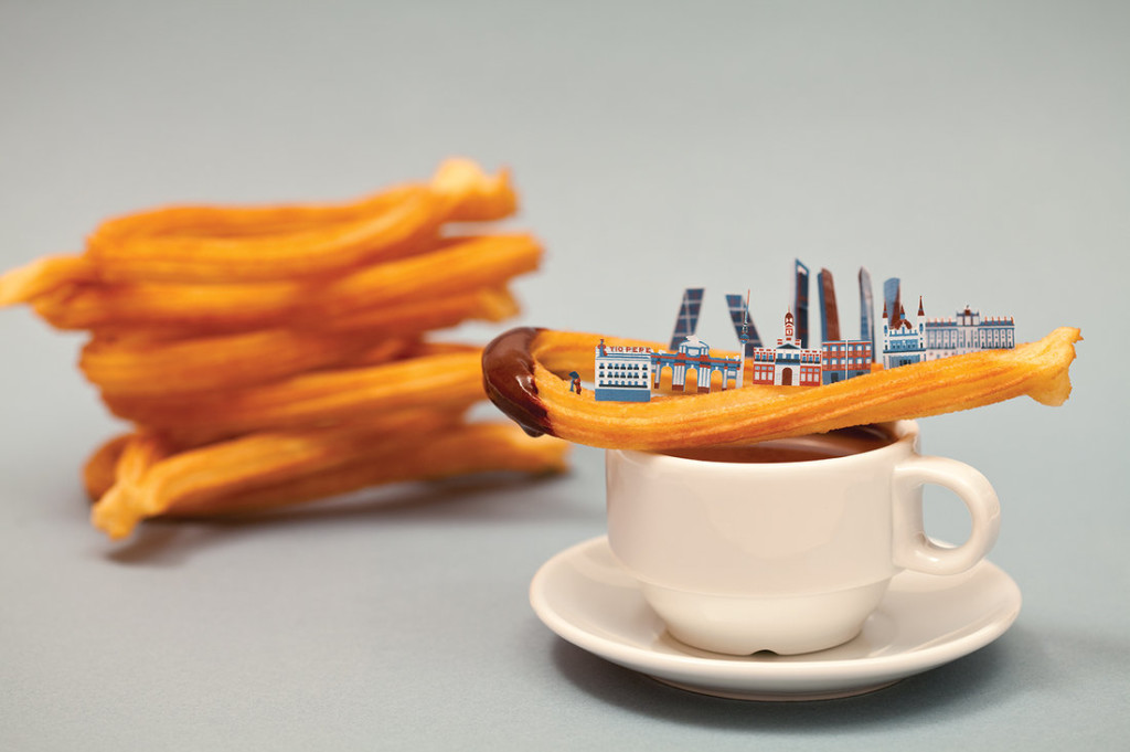 Madrid: A churro con chocolate is topped by local landmarks, including the iconic Tio Pepe neon sign that overlooks the city's central square, Le Puerta Del Sol. Courtesy of Bea Crespo and Andrea G.Portoles, via The Salt.